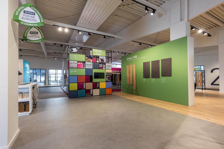 wineo workspace PURLINE Bioboden Betonoptik Holzoptik Ausstellung Messestand Bodenbelag Fußboden
