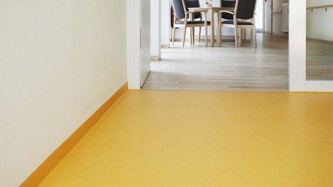 wineo PURLINE Bioboden Orange Holzoptik Flur