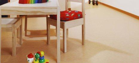 PURLINE Bioboden in einer Kita Kindertagesstätte Rollenware Orange