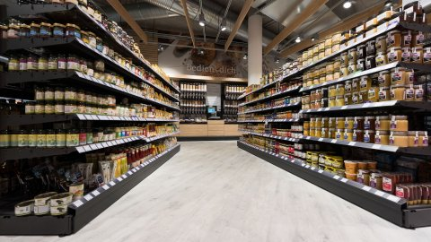 wineo Purline Bioboden Holzoptik Regal Holz Lebensmittel Biomarkt
