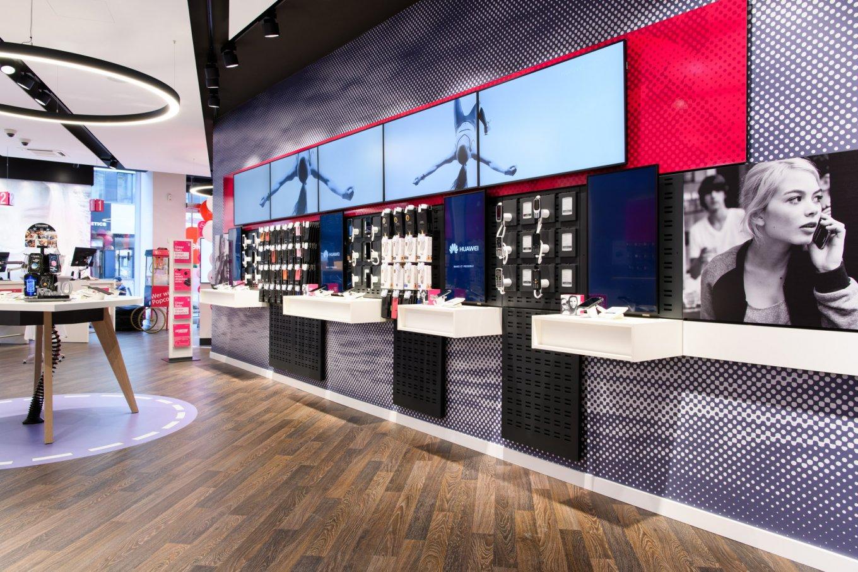 wineo Purline Bioboden dunkel modern Shop Video Wall
